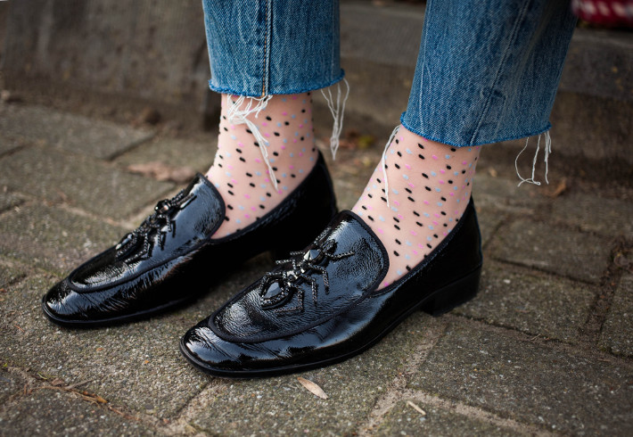 polkadot socks in loafers with raw hem denim