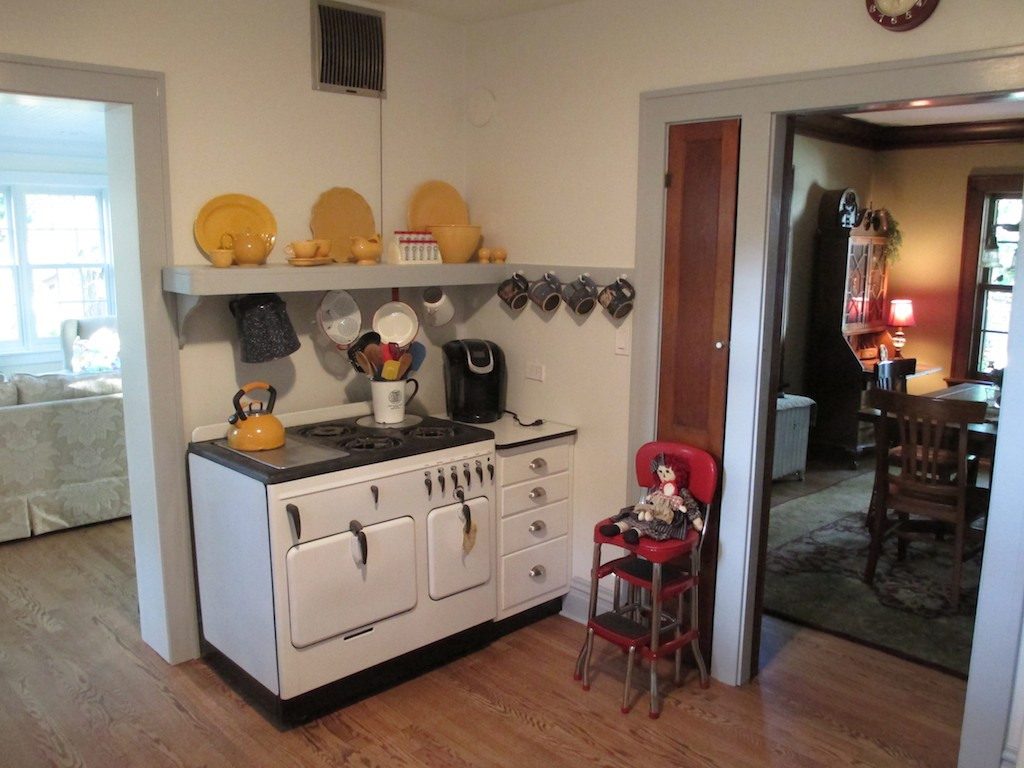 Vintage Chambers Stove Model B Blacktop In Corner Of Retro Kitchen With  Vintage Plates And Bowls