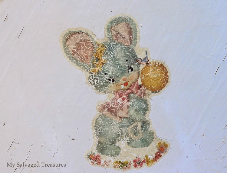 crackled decal from the end of an old doll cradle.