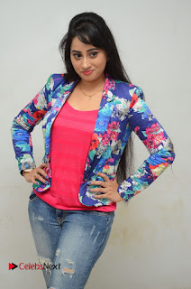 Television Anchor Actress Ashwini Pictures in Jeans at Iddharam Audio Launch 0018