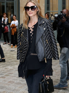 Olivia Palermo at Alexis Mabille Haute Couture 2016/17 show in a black studded leather jacket flowing black top and black jeans