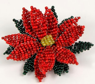 http://translate.googleusercontent.com/translate_c?depth=1&hl=es&rurl=translate.google.es&sl=en&tl=es&u=http://www.planetjune.com/blog/tutorials/beaded-poinsettia-tutorial/&usg=ALkJrhibI-RLpxuPsrGPrROYvlT3vyruhA
