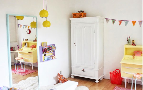 colourful children's bedroom with retro ceiling lights and painted furniture