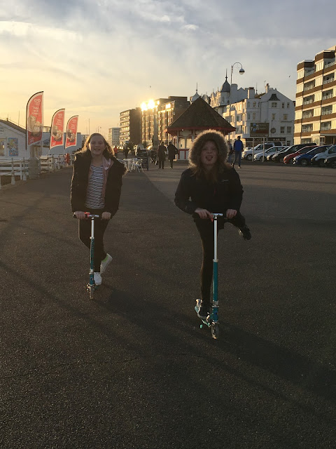 girls scooting on bexhill prom