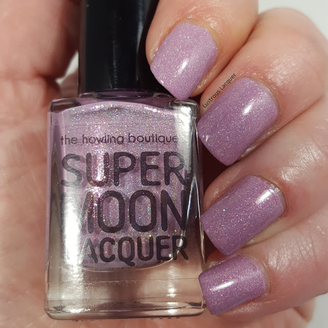 Pale lilac polish with holographic falkes