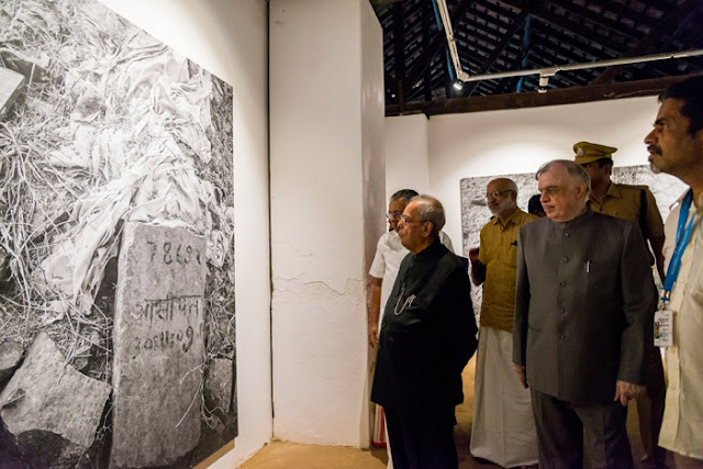 President Pranab Mukherjee watching Indian artist Gauri Gill's photo exhibition 'Traces' at Aspinwall House during his visit to Kochi Biennale. Kerala Governor Chief Justice (Retd) Shri  P Sathasivam , Chief Minister Shri Pinarayi Vijayan, former Minister M A Baby and  Kochi Biennale 2016 curator Sudarshan Shetty are seen along.