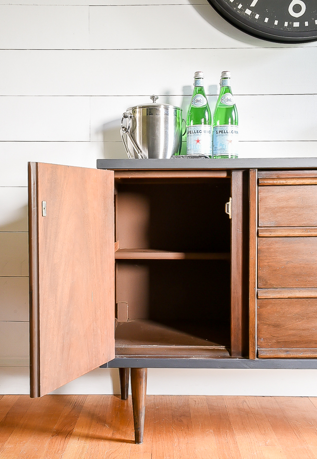 Inside cabinet of vintage Bassett server