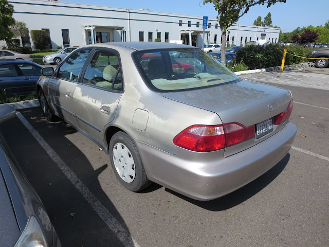 1999 Honda with faded & peeling paint before repairs at Almost Everything Auto Body