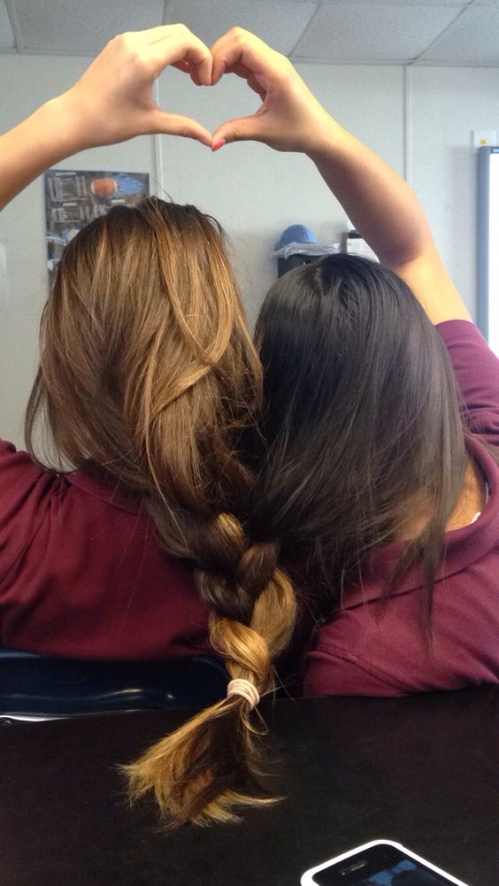 best friends braid their hair together