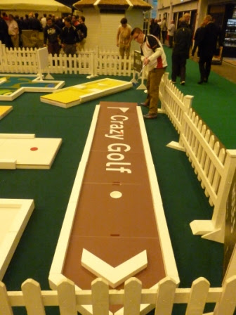 Following the Brown Sign for a Hole-in-One on hole 5 of the new UrbanCrazy 'Signature Course' at the London Golf Show!