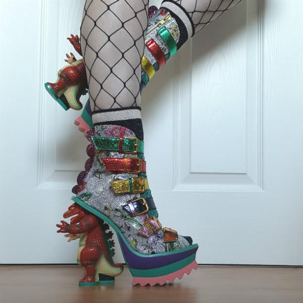 wearing floral patent ankle boots with dinosaur heels, wide fishnet tights and metallic socks