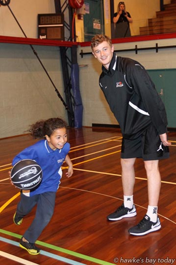 Right: Finn Delany - Sky City New Zealand Breakers basketball players held a training clinic with kids at Hastings Sports Centre, Hastings. photograph