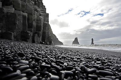 Vík's black sand and black pebble volcanic beaches