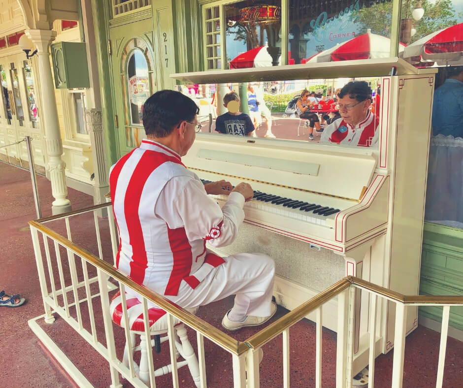 Top 7 Things You Should Do At Magic Kingdom, Walt Disney World | See the pianist at Casey's Corner...