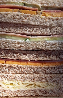 Close up picture of sandwiches sliced in half, showing bread and fillings for my thrifty packed lunches