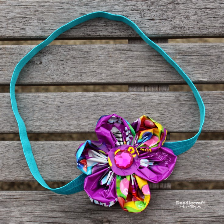 Skittles Flower Headband  More candy wrapper crafts! Make a flower headband using an old skittles bag.
