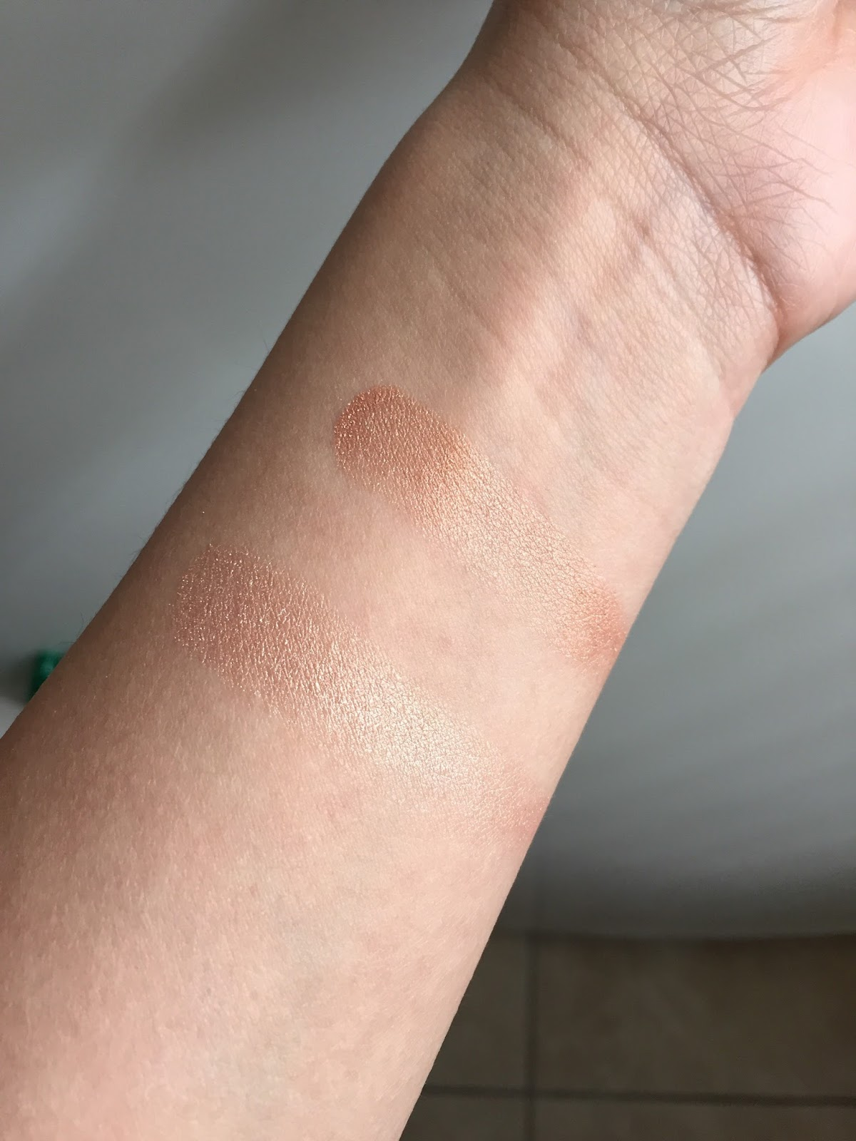 Swatches of Wet n Wild highlighter in precious petals & crown of my canopy