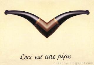 La imagen muestra la cánula de la pipa, espejada formando una pseudopipa inusable, bajo la que hay escrito en francés: Esto es una pipa.