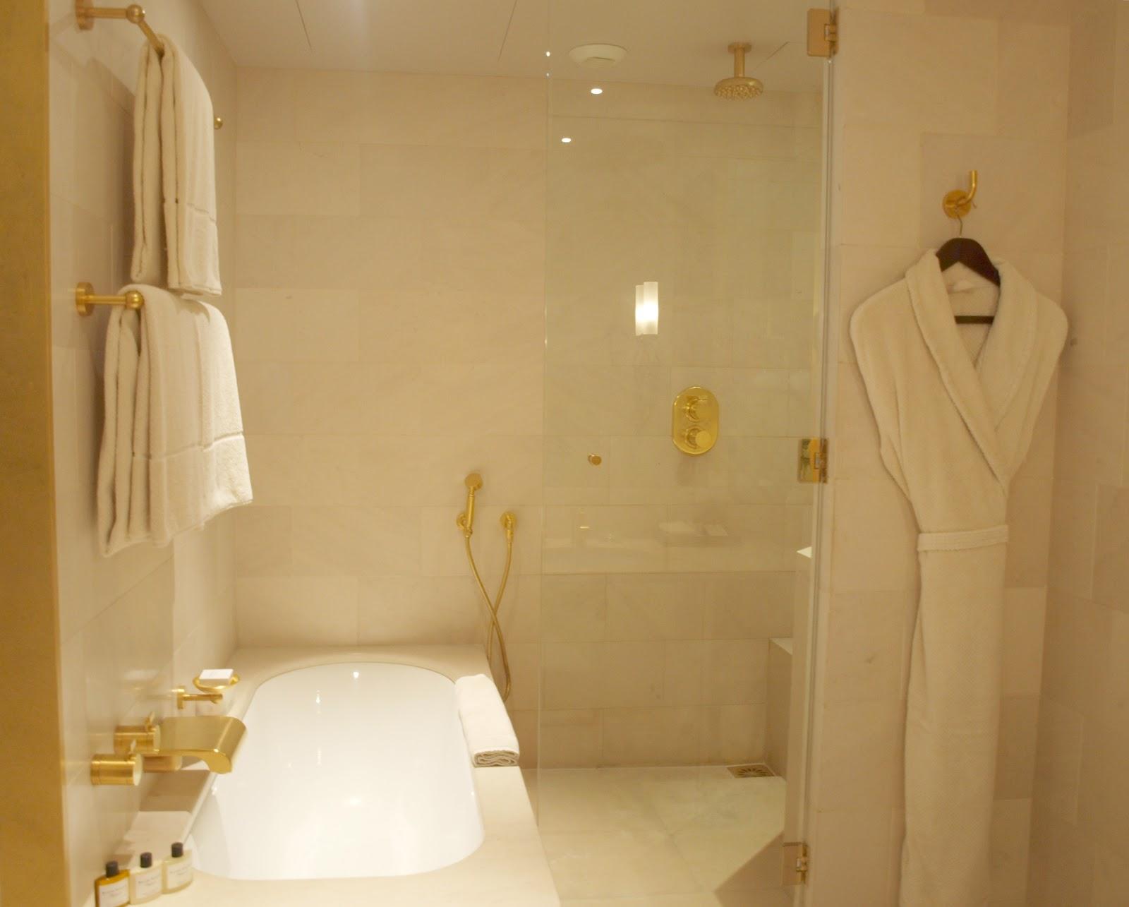 Luxurious limestone bathroom in Park Hyatt Paris Vendome by Hello Lovely Studio