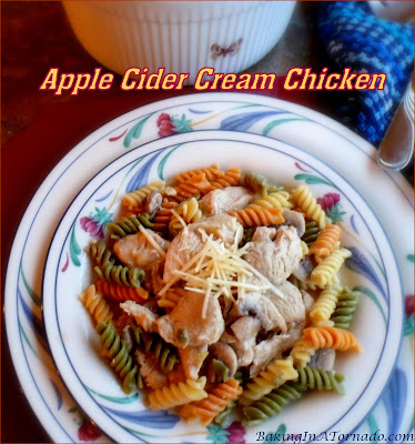 Apple Cider Cream Chicken, a flavorful, easy, hearty dinner. Sliced chicken cooked in a creamy sauce made with apple cider, then tossed in tricolor rotini. | Recipe developed by www.BakingInATornado.com | #recipe #dinner