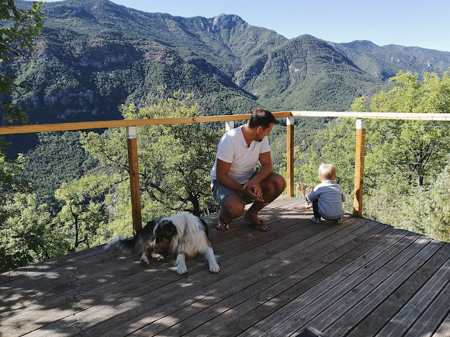 Father and son enjoying a gorgeous mountain view