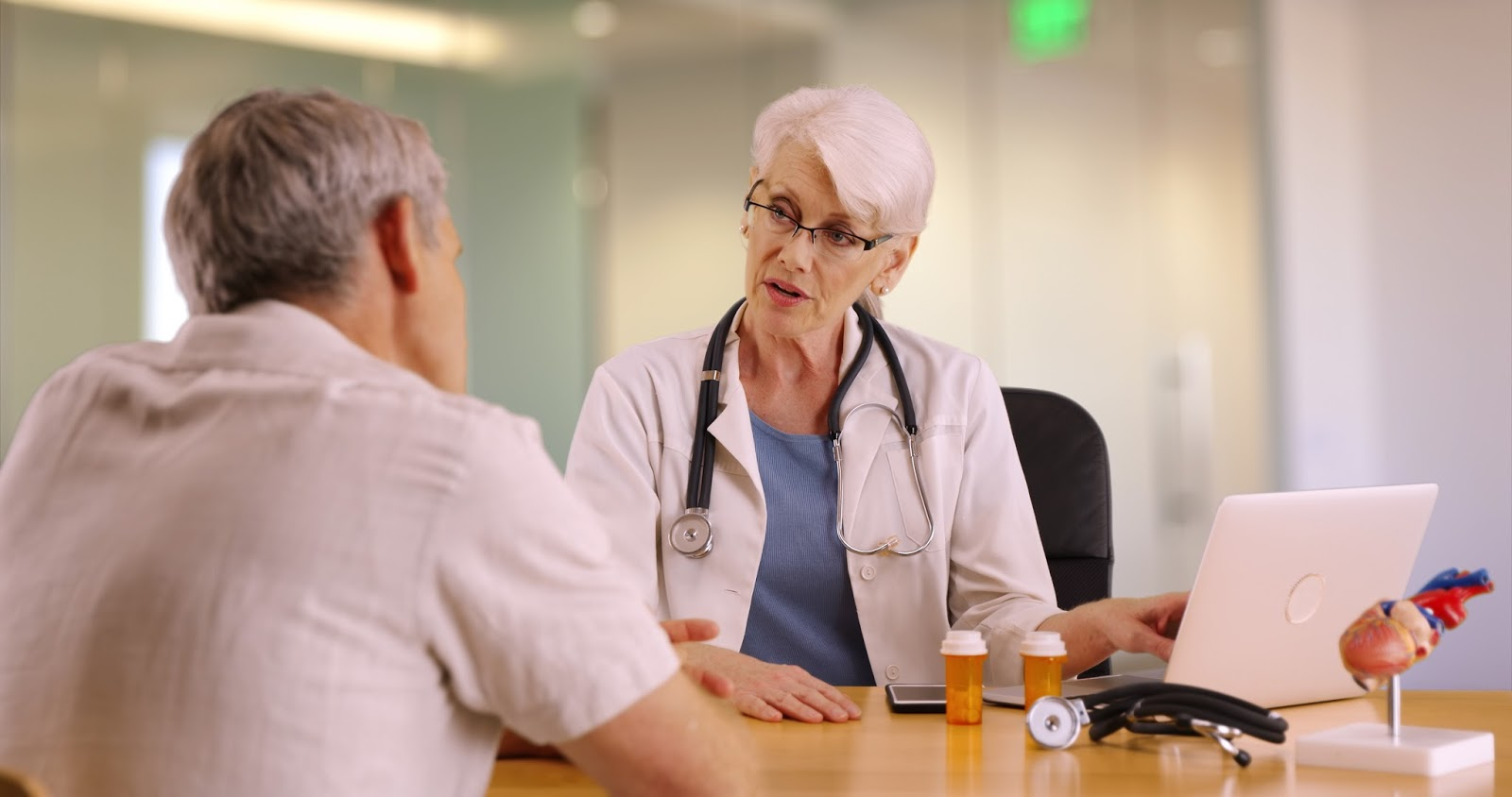 Older man consults with his doctor