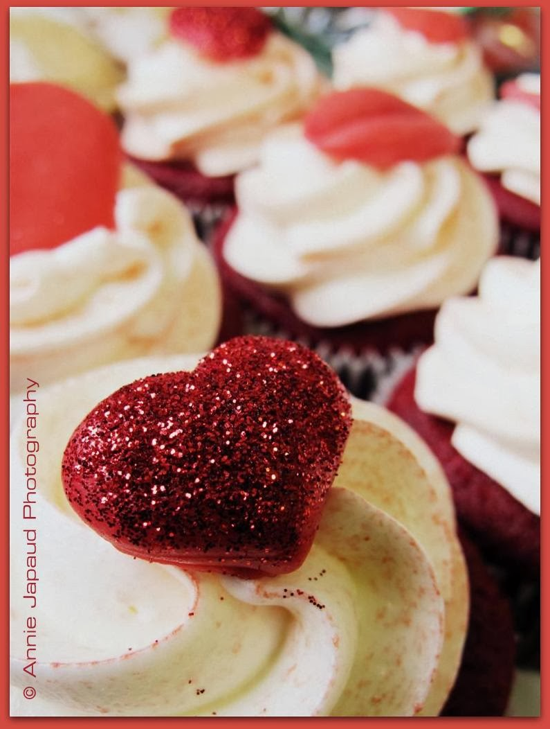 a  cup cake with a sparkling heart decoration