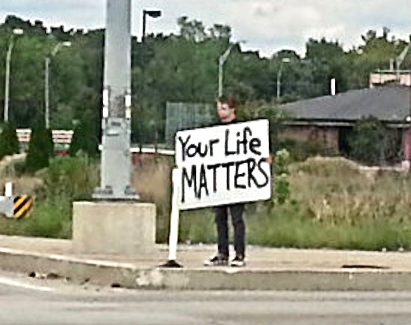 "Standing on the corner with a sign ""Your Life Matters."" Close up More of this guy! marchmatron.com"