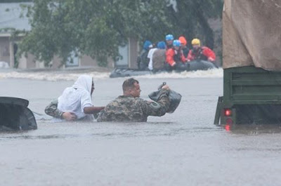 North Carolina National Guard and local emergency services assist with evacuation efforts as a result of heavy rains and flooding