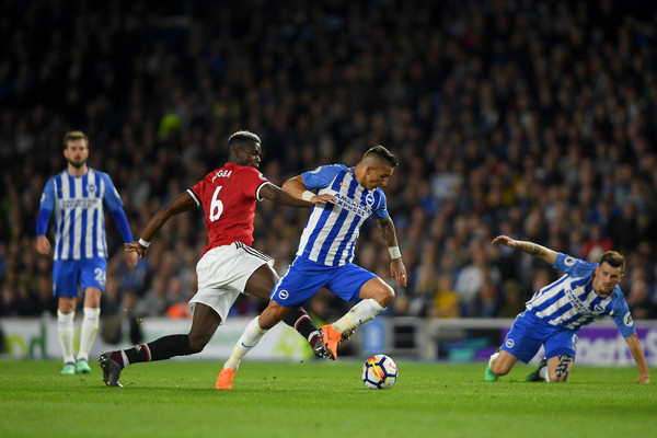 Anthony Knockaert of Brighton & Hove Albion battles for the ball with Paul Pogba of Manchester United during the Premier League match between Brighton and Hove Albion and Manchester United at Amex Stadium on May 4, 2018 in Brighton, England. (May 3, 2018 - Source: Mike Hewitt/Getty Images Europe)
