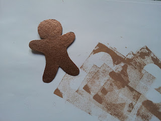 Gingerbread man shape embossed in copper with cinnamon added