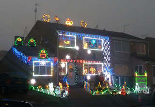 One Semi Detached House Covered in Xmas Lights