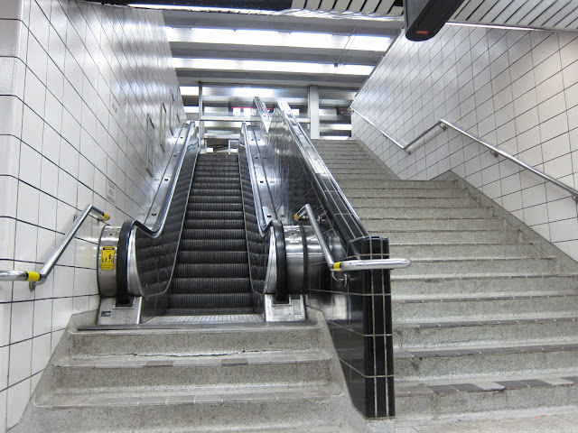 The steps are necessitated by the need for space for the escalator mechanicals.