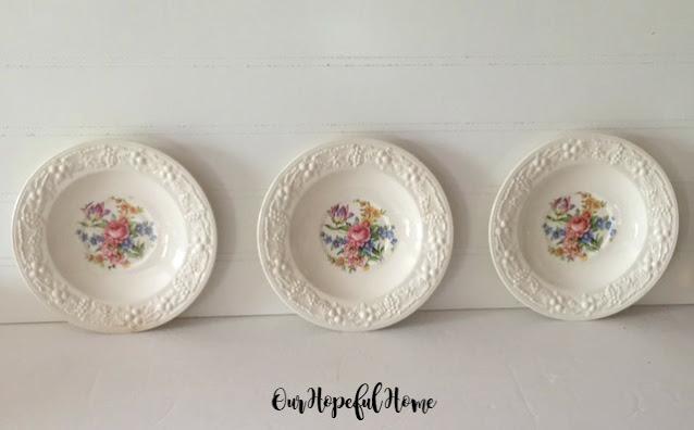 trio creme floral plates