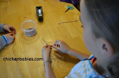 making wish bracelets at a tween girl birthday party