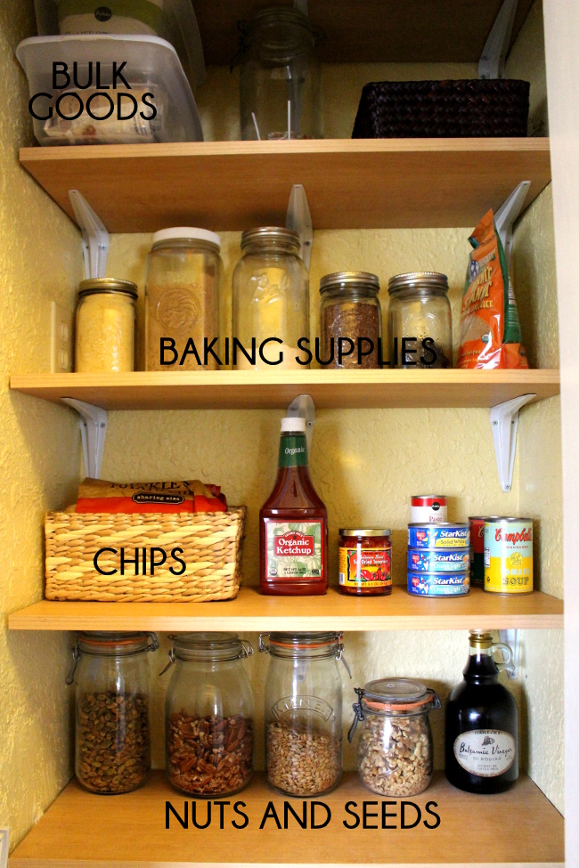 Organizing pantry shelves with jars and baskets