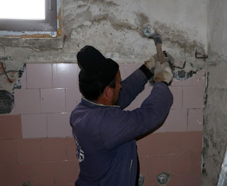 Using a chisel to remove tiles