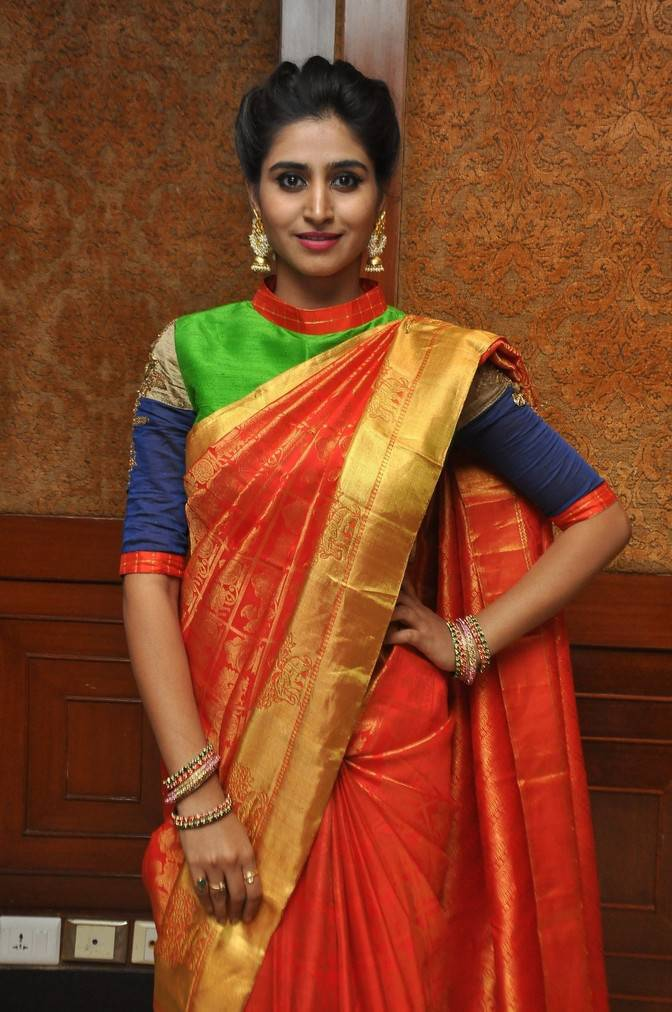 Shamili Stills In Orange Saree At Fashion Show