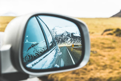 Rearview mirror of Ring Road in Iceland during winter road trip