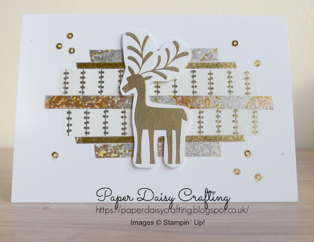 Pretty little Christmas card featuring a stamped and heat embossed reindeer from Stampin' Up!'s Merry Mistletoe set