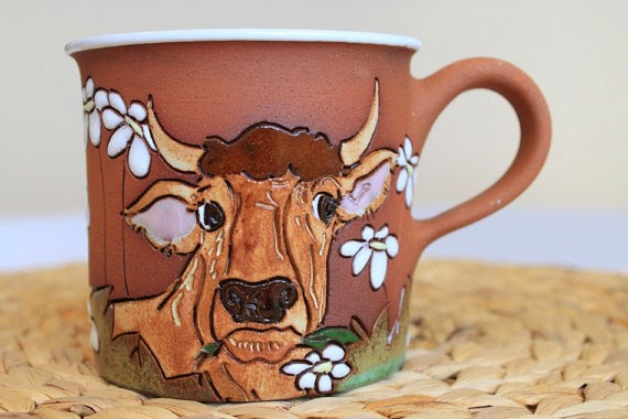 https://www.etsy.com/listing/179489952/tea-mug-with-brown-bull-and-daisies?ref=favs_view_4
