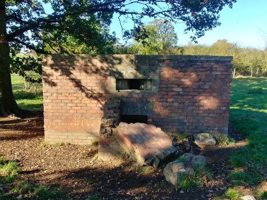 Photograph of The collapsed entrance to the type 24 pillbox in the fields of Boltons Park Farm Image by the North Mymms History Project released under Creative Commons BY-NC-SA 4.0