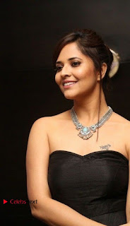 Telugu Anchor Actress Anasuya Bharadwa Stills in Strap Less Black Long Dress at Winner Pre Release Function  0013.jpg