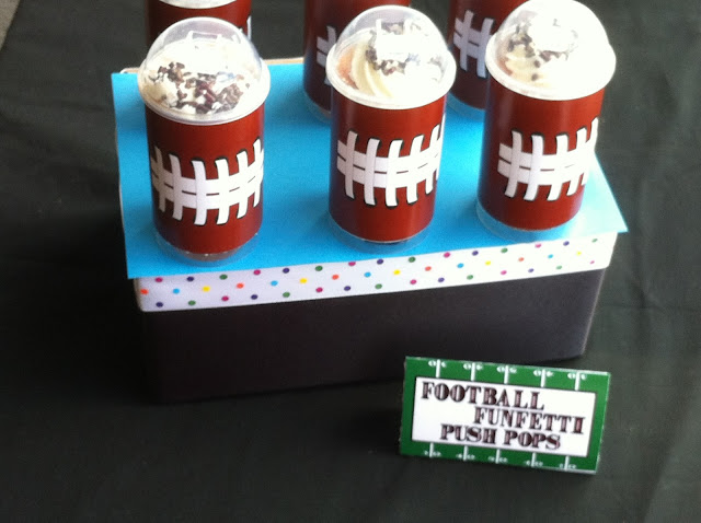 Have a fun treat at your football party or super bowl party with these yummy football push pop treats.  Using simple containers you can get at any craft store and these football free printables, you'll have an easy and fun party treat in no time.