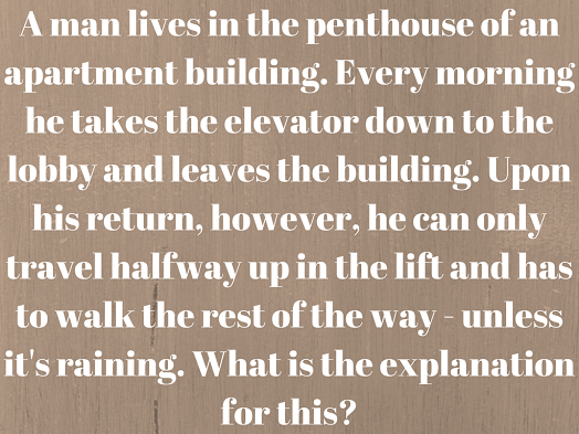A man lives in the penthouse of an apartment building. Every morning he takes the elevator down to the lobby and leaves the building. Upon his return, however, he can only travel halfway up in the lift and has to walk the rest of the way - unless it's raining. What is the explanation for this?