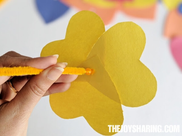 kids can use a bead in this craft to hold the flower petals.