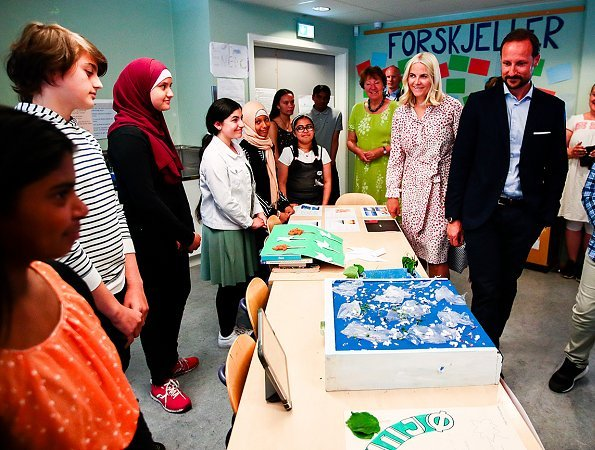 Crown Princess Mette Marit wore Vilshenko Heidi Belted Printed Silk dress. Linderud School has more than 600 students and 100 employees