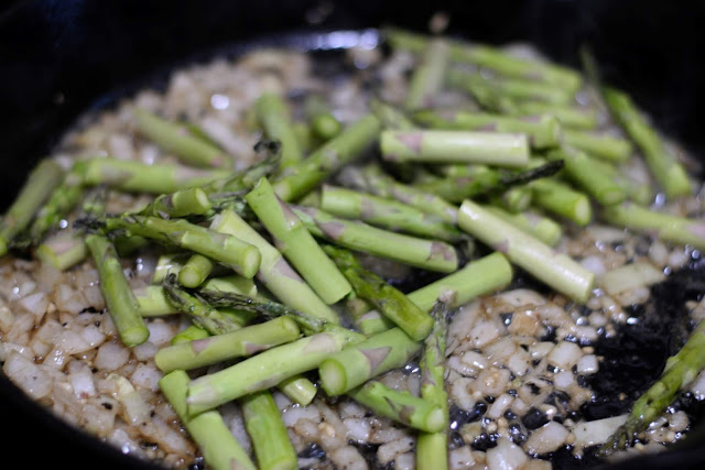 The asparagus added to the cast iron skillet.