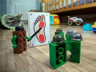 treading on lego blocks on a kids bedroom floor