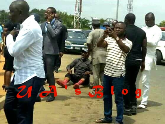 Watch Video of Senator Dino Melaye Sitting On The Floor While Resisting Police Arrest Emerges